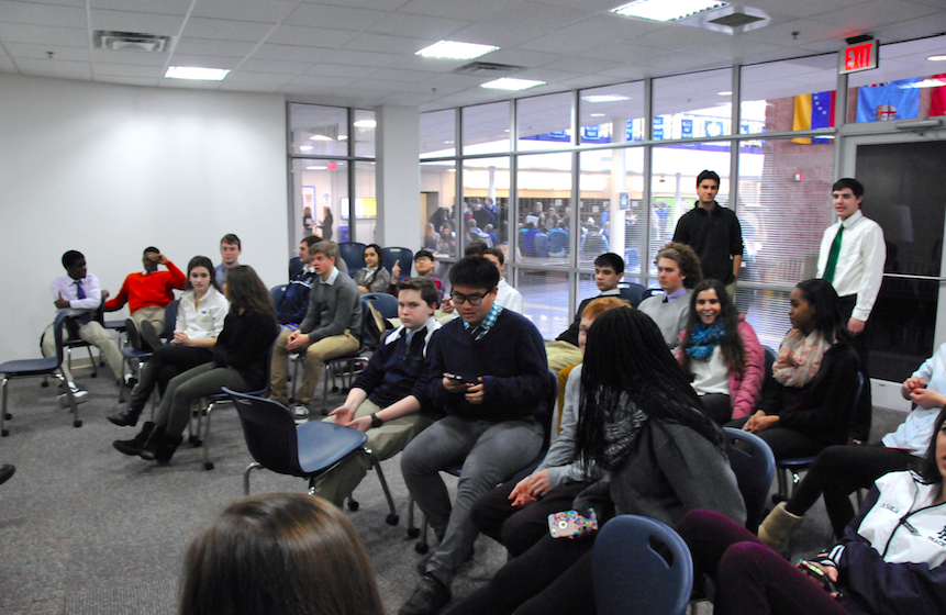 Students engage in a post-presentation discussion with facilitators from Speak About It.