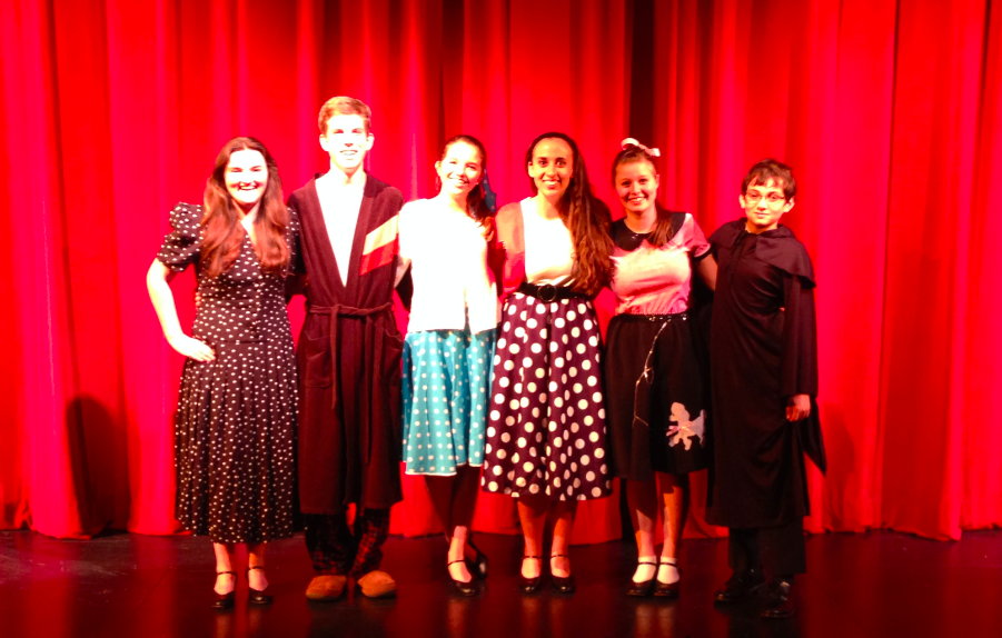 Cast members pose after the opening performance.