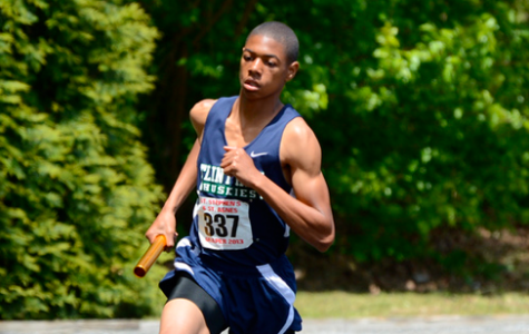 Flint Hill's Darron Coley bears the torch on the track