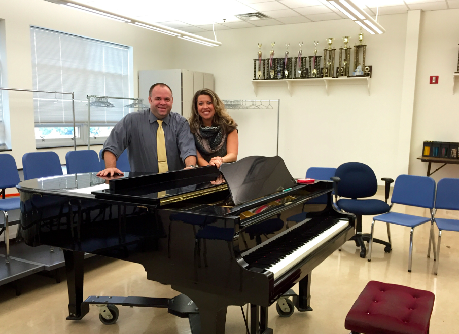 Dr. Scott and Mrs. Pramstaller are working in the choir room.