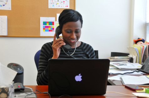 Mia Burton, the new Director of Diversity and Inclusion, answers a phone call.