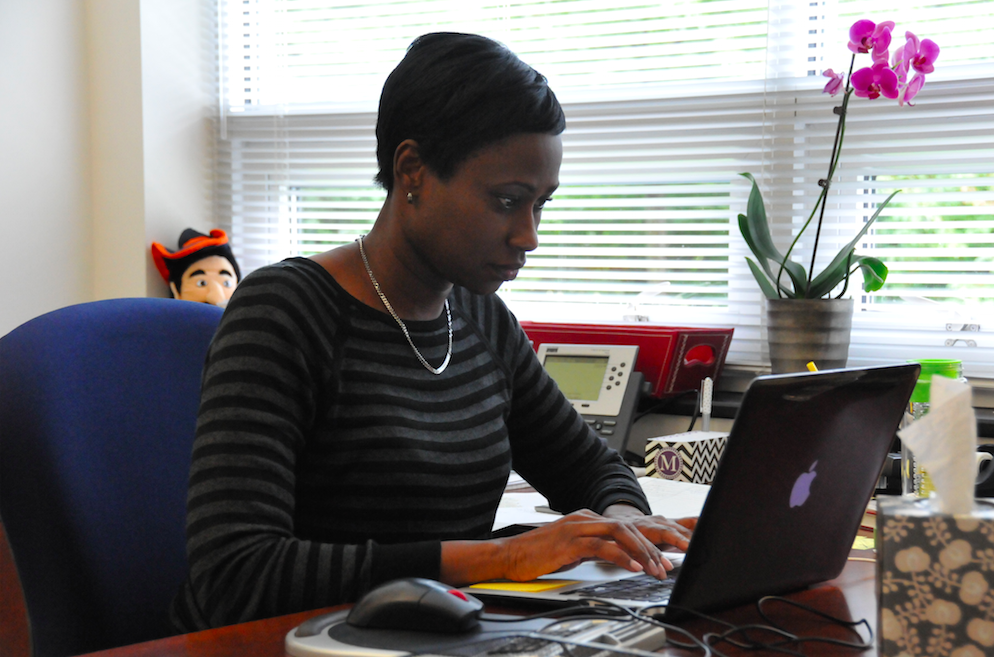 Mia Burton, Director of Diversity and Inclusion, replies to emails in her office.