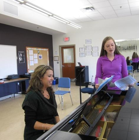 Pramstaller works through a piece of choral music with junior Michelle Pawlow.