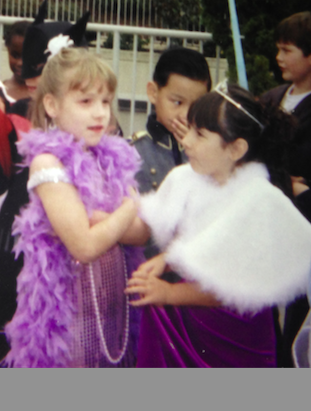 Current-day seniors Charlotte Sadar, left. and Alexandra Cline, right, smile in a Halloween photo from 2001. Photo Credit: Charlotte Sadar