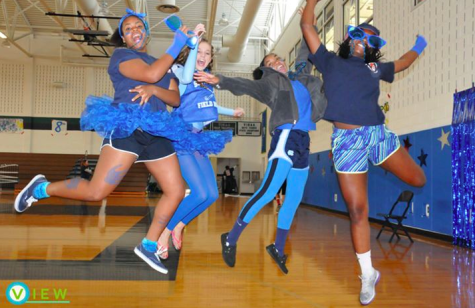Juniors Uchenna Nckenchor, Sydney Britton, Taylor Lucas, and Tamika Alexander jump for joy before the Pep Rally.