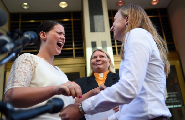 Jennifer Melsop, left, screams for happiness after being married to her partner, Erika Turner, in front of Arlington County Courthouse. Photo Credit: Astrid Riecken/For The Washington Post.