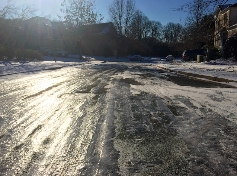 As seen in this photo from a Vienna neighborhood on the morning of Thursday, January 8, 2015, roads remained visibly icy as Flint Hill made the decision to stay open despite an FCPS closure.