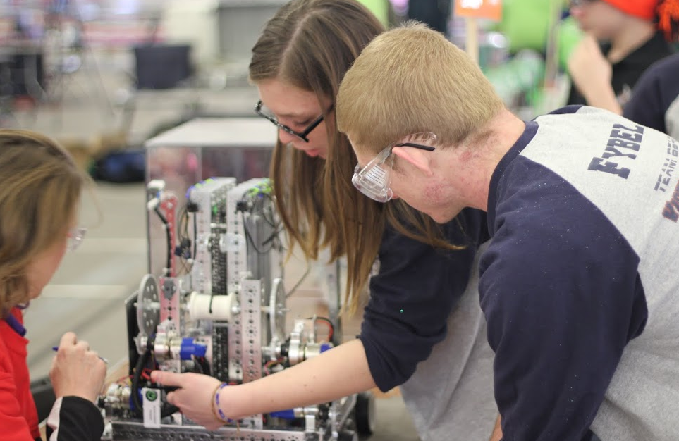 Juniors Benjamin Fybel and Cailin Mazan work on their robot at the RIchmond state robotics championship.