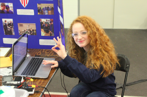 Member of 6652 senior Stacey Keister works on the robot's program, all the while encouraging fellow team members that everything is a-okay. Photo credit: Michael Snyder