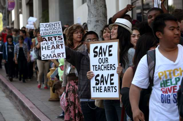 California citizens march to protest school budget cuts.