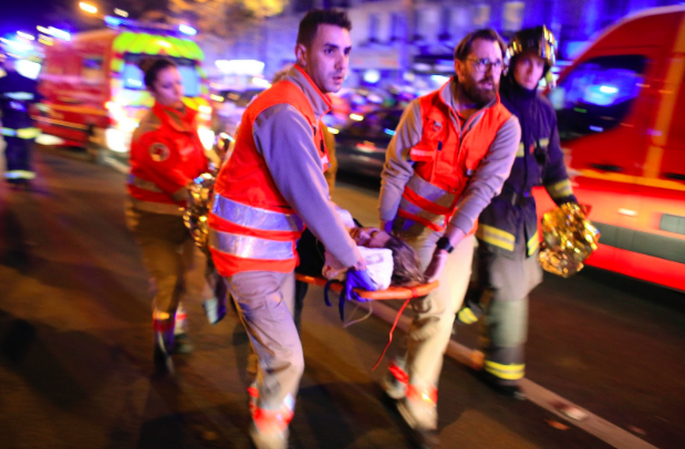 A woman is evacuated from the Bataclan concert hall in Paris on November 13.