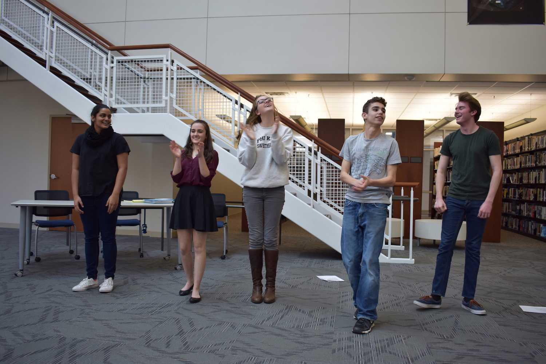 Freshman Jansi Patel, sophomore Hannah Yasmin Khan, Kramer, sophomore Sebastian Van Der Weide, and freshman Calvin Lucido revel in the applause.
