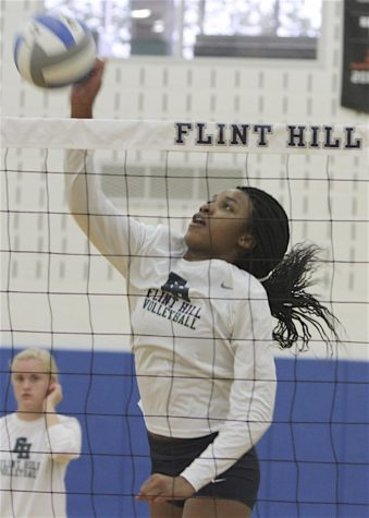 Senior Siron Hardy kills the ball. Hardy has committed to play Division 1 volleyball at George Mason University.