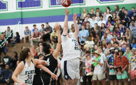 Varsity Girls' Basketball player Madison Jordan goes for a rebound against Westfield.