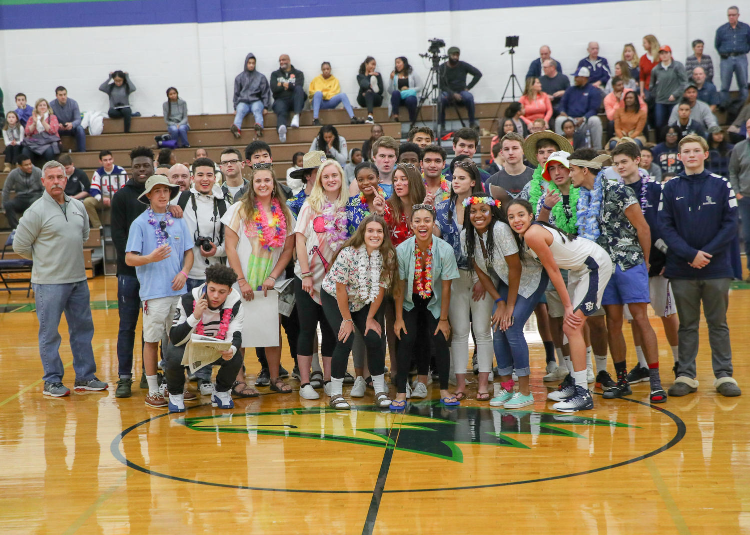 Students who attended the Winterfest games pose in the middle of the gym.