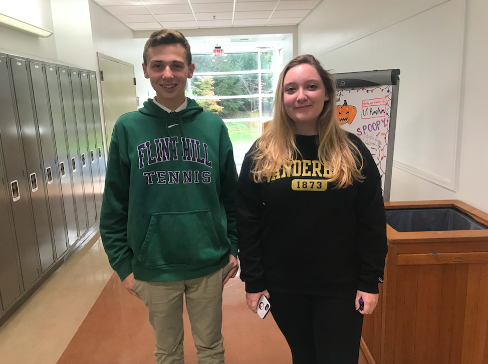 Sophomore Alessandro Silva (left) and Senior Lily Kyser (right) wear newly approved hoodies