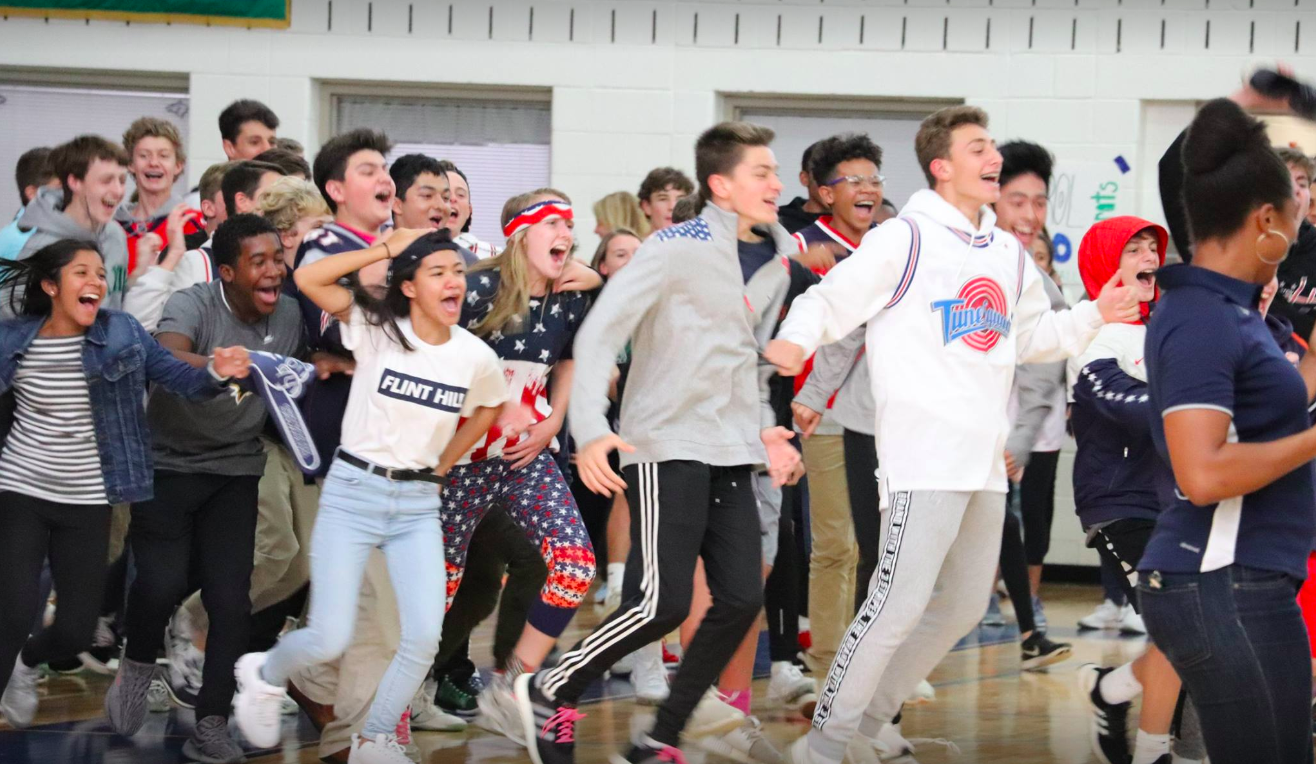 Students demonstrate school spirit in the gym